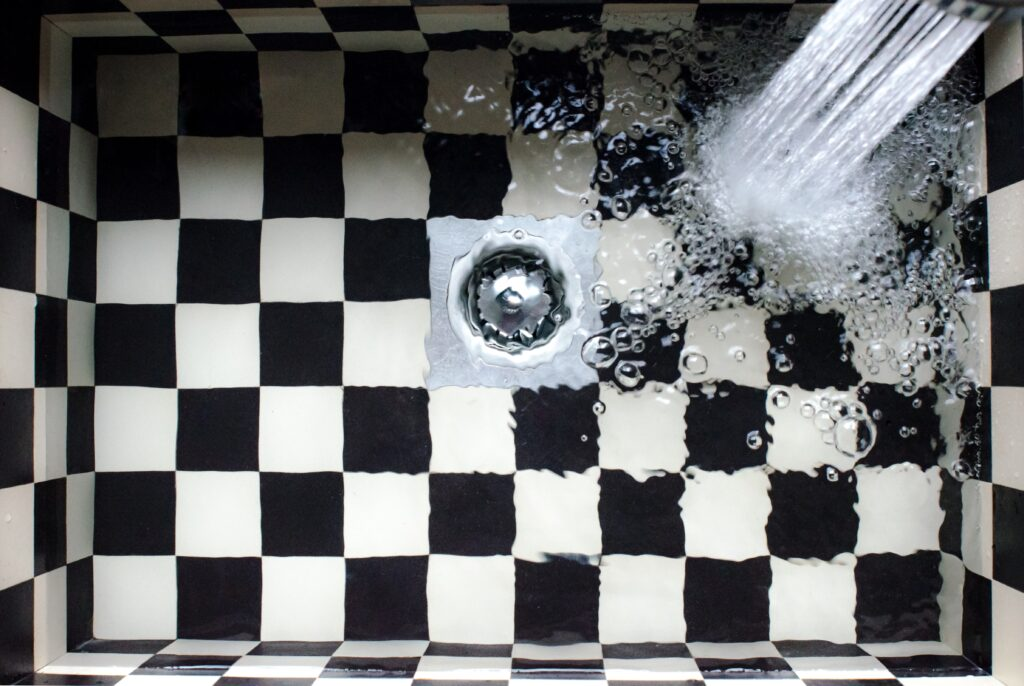 Drain Backing Up? Why You Should Consider Clogged Drain Service from Custom Plumbing